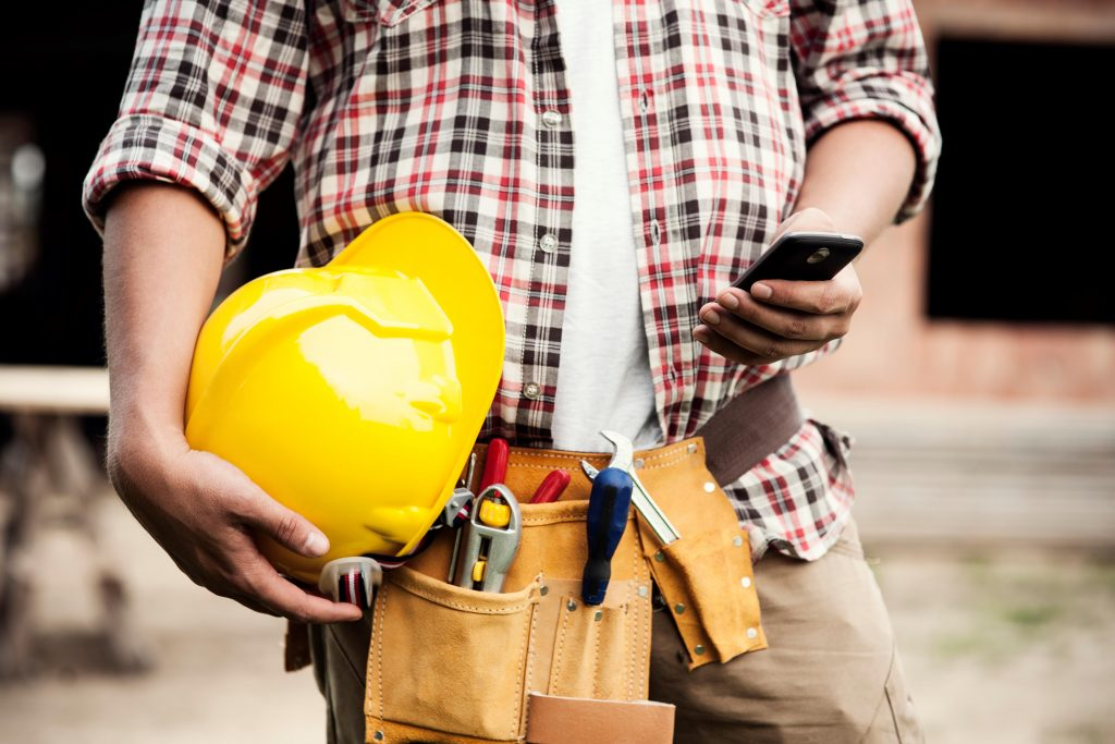 Worker calls Houston Construction Accident Attorney from Construction Site