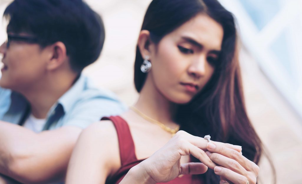 wife looks at wedding ring and thinks about consulting a divorce lawyer in Houston